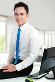 Young asian business man at the office — Stock Photo