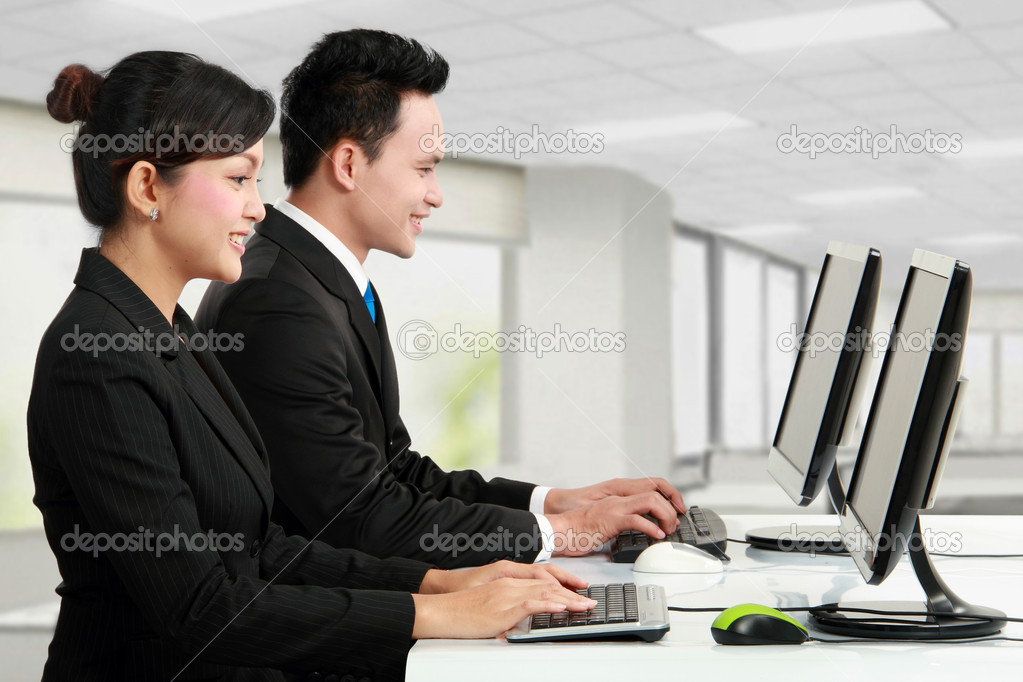Woman and man office worker working in the office — Stock Photo #11145490