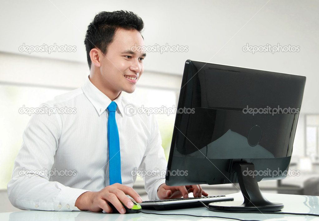 Portrait of a young business man with computer working in the office  Foto Stock #11146324