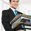 Business man holding stack of files and folders — Stock Photo #11244022
