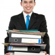 Business man holding stack of files and folders — Stock Photo #11244025