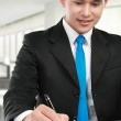 Young business man writing — Stock Photo