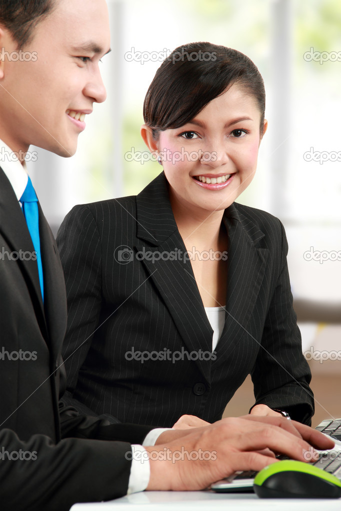 Face of beautiful woman at the background of business working  Photo #11244707
