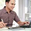 Man working with laptop at his desk — Stock Photo #11409444