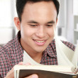 Male reading a book — Stock Photo #11409462