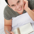 Asian male with his diary — Stockfoto