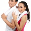 Fitness Smiling young couple man and woman - Stock Photo
