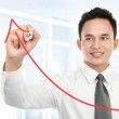 Young businessman drawing statistic — Stock Photo