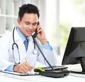 Male doctor working — Stock Photo