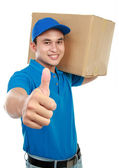 Delivery man thumb up — Stock Photo