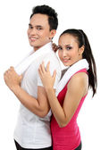 фитнес улыбаясь молодая пара мужчина и женщина — Стоковое фото