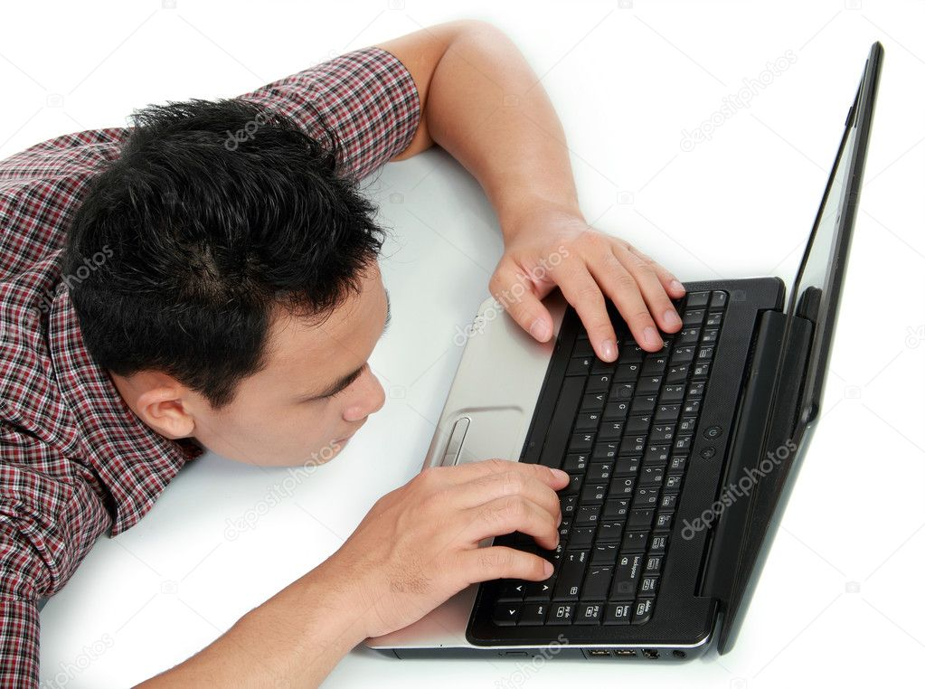 Tired man with head down on laptop  Stock Photo #11409427