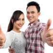Couple two thumbs up sign — Stock Photo #11410090