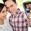 Stock Photo: Young couple taking self portrait