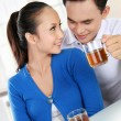 Young couple having a tea — Stock Photo