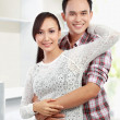 Young happy couple at their new house — Stock Photo #11410327