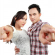 Happy couple pointing — Stock Photo #11410371
