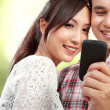 Couple with phone — Stock Photo