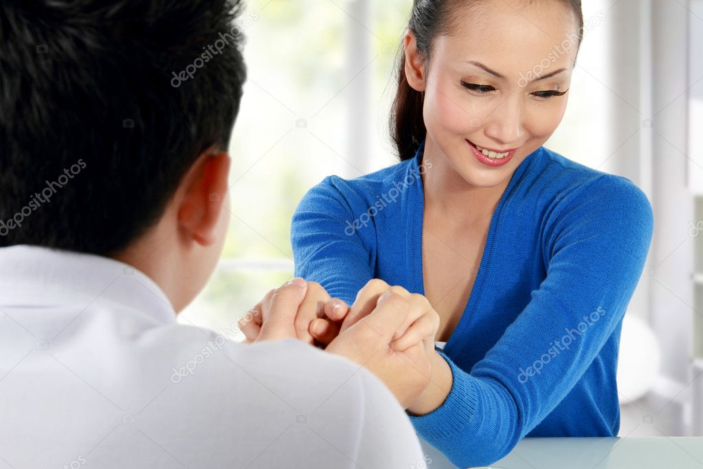 Young man proposing marriage to surprised woman — Stock Photo #11410255