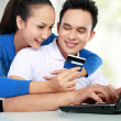 Stock Photo: Happy couple shopping online