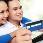 Happy couple shopping online — Stock Photo #11487139
