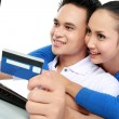 Happy couple shopping online — Stock Photo