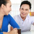 Stock Photo: Young couple having a tea