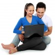 Couple with laptop, sitting on floor — Stock Photo