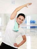 Young man stretching — Stock Photo