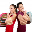 Shopping couple showing thumb up — Stock Photo