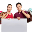 Shopping couple with blank board — Stock Photo #11501115