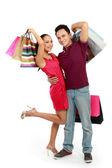 Szczęśliwa para z torbą na zakupy — Zdjęcie stockowe