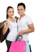 Young couple with shopping bag — Stock Photo