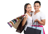Attractive happy couple shopping — Stock Photo
