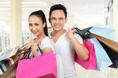 Man and woman carrying shopping bag — Stock Photo