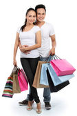 Attractive couple with shopping bag — Stock Photo
