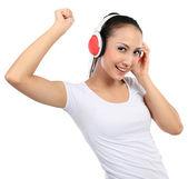 Kvinna dansar till musik med hörlurar — Stockfoto