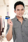 Man with credit card — Stock Photo
