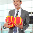Businessman with christmas gift — Stock Photo