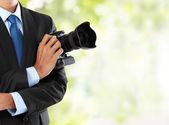 Photographer with dslr camera — Stock Photo