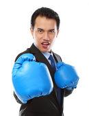 Businessman using boxing glove — Stock Photo