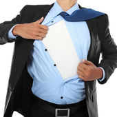 Businessman showing a superhero suit — Stock Photo