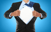 Businessman showing a superhero suit — Foto de Stock