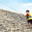 Kid climbing using rope — Stock Photo