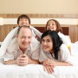Stock Photo: Happy family in the bed