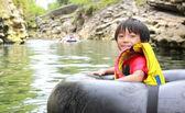 Kid on inflatable tube — Stock Photo