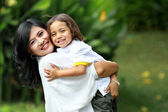 Cute cheerful child with mother — Stockfoto
