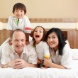 Happy family in the bedroom — Stock Photo #11917102
