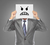 Businessman with angry mask — Stock Photo