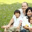 Happy family in the park — Stock Photo #12022144